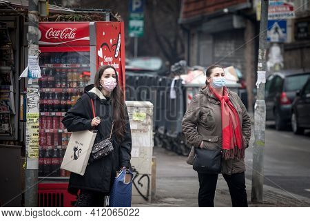 Belgrade, Serbia - February 20, 2021: Women, Young Girls And Old Woman, Walking Wearing Face Mask Re