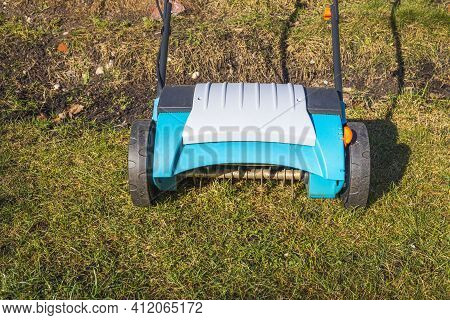 View Of Electric Lawn Aerator On Green Grass Isolated. Garden Machines Concept. Sweden.