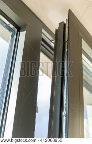 Aluminum Window Open Detail. Metal Door Frame Closeup View.