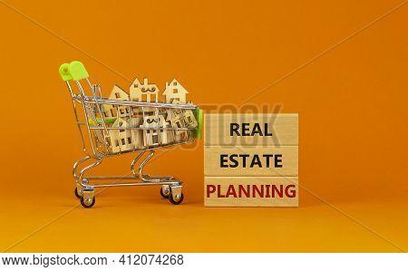 Real Estate Planning Symbol. Wooden Blocks, Words 'real Estate Planning' On Beautiful Orange Backgro