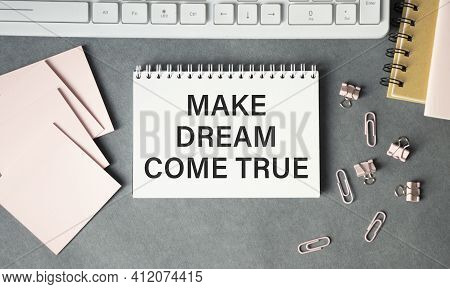 Make Your Dreams Come True Text Written On Notepad With Pen On Financial Documents.
