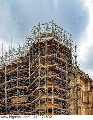 Scaffolding around a building renovating facade