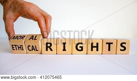 Ethical Or Moral Rights Symbol. Businessman Turns Wooden Cubes And Changes Words Ethical Rights To M