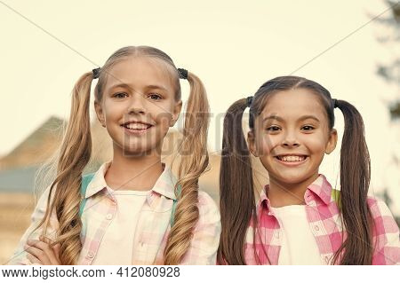 Perfection In Beauty. Happy Kids With Long Hair Tails. Beauty Look Of Small Girls. Beauty Shop. Hair