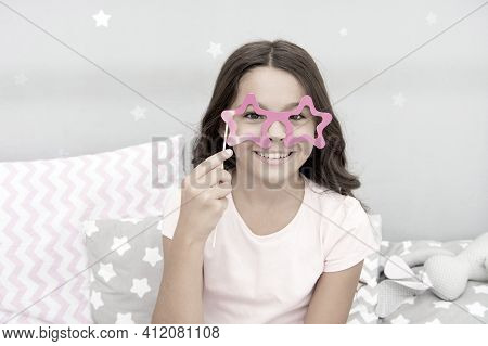 Slumber Party Photo Booth Props. Kid Girl Cheerful Posing With Star Shaped Eyeglasses Party Attribut