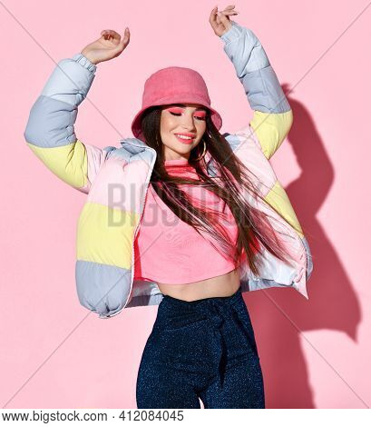 Chic Teenager Girl Model In Motion Beauty Studio Portrait Isolated On Pink Background. Beautiful You