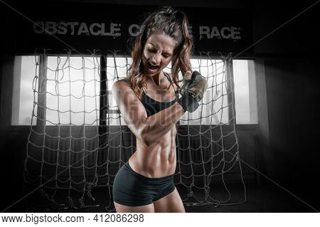 Beautiful Athlete Screams And Strains Her Biceps After A Training Approach. The Concept Of Shaping,