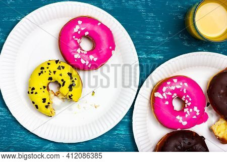 A Plate Of Donuts. Party On The Summer Veranda. Bitten Donut On A Stall. A Half-eaten Donut.