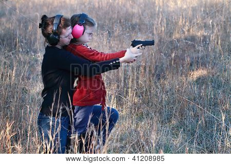 Mom And Daughter Practicing Shooting