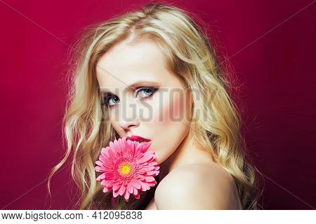 Closeup Afce Portrait Of Beautiful Passionate Blonde Woman Holding Gerbera Flower Near Face Isoalted
