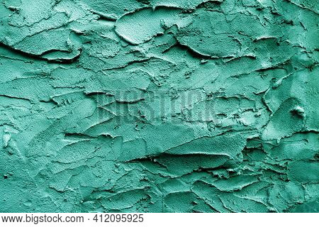 Uneven Rough Green-turquoise Texture. Texture Of Green-turquoise Rough Wall Surface.
