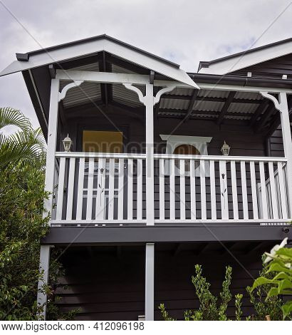 Brisbane, Queensland, Australia - March 2021: A Renovated Timber Queensland Home In Contrasting Colo