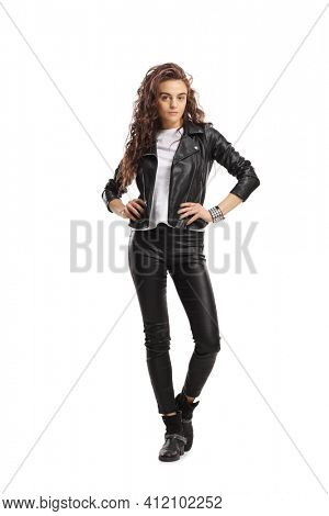 Full length portrait of a young female in a leather jacket posing isolated on white background