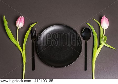 Festive Creative Black Table Setting With Tulips On Dark Background