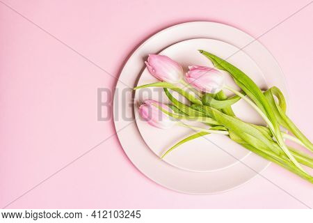 Festive Creative Pink Table Setting With Tulips On Gentle Rosy Background