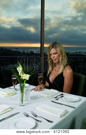 Beautiful Blond Having Dinner