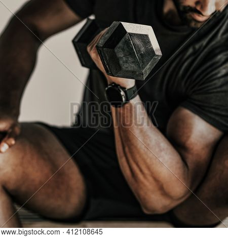 Muscular man weightlifting with a dumbbell
