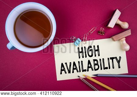 High Availability. Tea Cup And Office Supplies On A Red Background