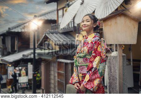 Asian Woman Wearing Japanese Traditional Kimono At Yasaka Pagoda And Sannen Zaka Street In Kyoto, Ja