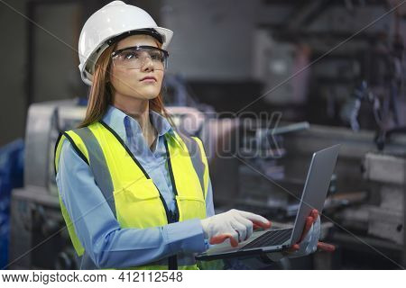 Asian Factory Worker Woman Hold Laptop And Smile Also Look To Camera In Workplace Area In Front Of D