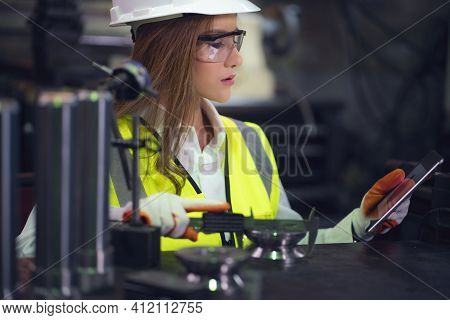 Industrial Worker Inspector Measuring Detail With Vernier Caliper In Factory Workshop