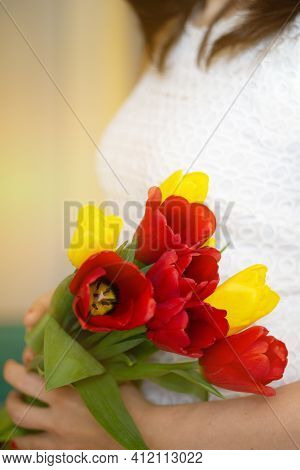 Soft Focus Of Anonymous Female Carrying Bunch Of Colorful Fresh Tulips During Holiday Celebration In