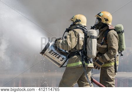 Firefighters Extinguishes Fire From Fire Hose, Using Fire-fighting Water-foam Barrel With Air-mechan