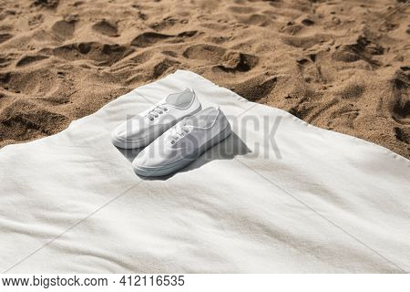 White sneakers on beach towel summer vibes photography