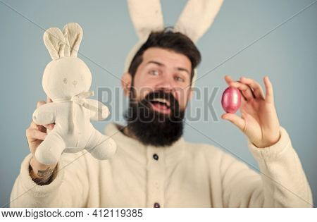 Easter Bunny. My Precious. Funny Bunny With Beard And Mustache Hold Pink Egg. Easter Symbol Concept.