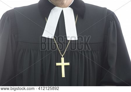 An Evangelical Pastor In Black Clothing Wearing A Golden Cross