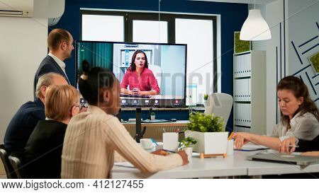 Group Of Diverse Business People Talking On Video Conference With Colleague Woman. Remote Video Call