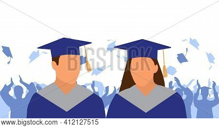 Girl And Boy Graduate In Mantle And Academic Square Cap On Background Of Cheerful Crowd Of Graduates