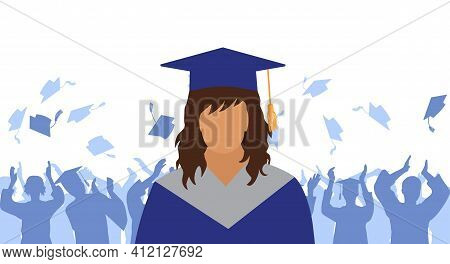 Graduate Girl In Mantle And Academic Square Cap On Background Of Cheerful Crowd Of Graduates Throwin