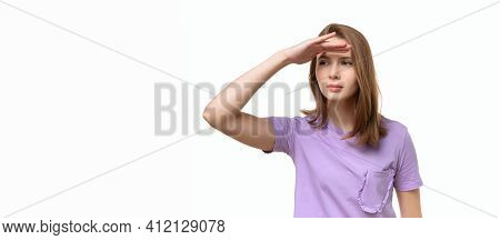 Pretty Girl Looking Far Away With Hand To Look Something. Young Girl Portrait With Arm On Forehead