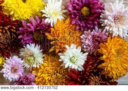 Beautiful Bouquet Of Mixed Flowers In A Vase On Wooden Table. The Work Of The Florist At A Flower Sh