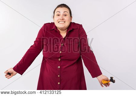 Young Blonde, Caucasian Plus Size Woman Wearing Dress Holding Wrench Clueless With Confused Expressi