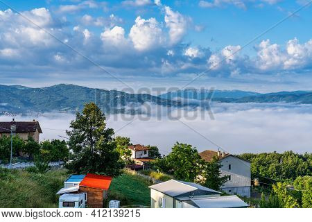 Foggy Morning View From The Hills Of San Capone To The Sibillini Mountains Park In Italy, Europe