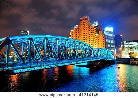 Shanghai Waibaidu bridge at night with colorful light over river
