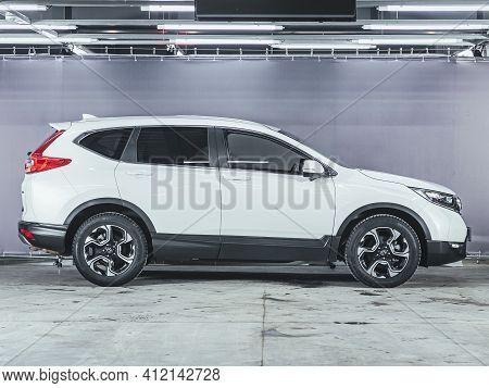 Novosibirsk, Russia - March 2 2021: Honda White New Cr-v, Side View. Photography Of A Modern Car On