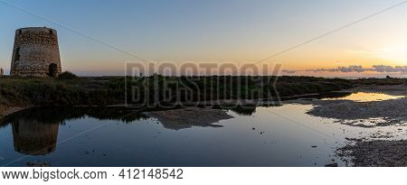 A Panorama View Of Old Windmill Ruins And Tidal Pools On The Coast Of Murcia At Sunset