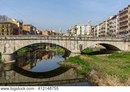 Girona, Spain - 11 March, 2021: The Historic Old City Center Of Girona In Northern Spain With Ist Ma