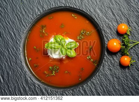 A Soup Of Red Tomatoes Solanum Lycopersicum With Herbs