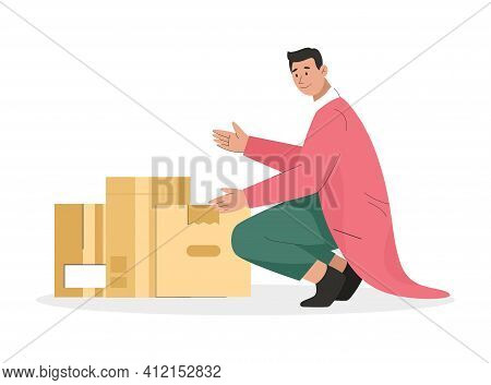 Man Holding Cardboard Box With Things. Young Guy Packing Belongings In Many Boxes