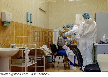 Uzhgorod, Ukraine - March 11, 2021: A Doctor Immunizes Health Workers At A Regional Clinical Hospita
