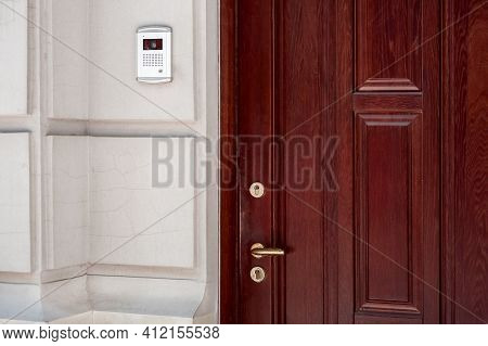 Brown Wooden Front Door Cracked Stone Facade Light Building Exterior With Intercom For Security With