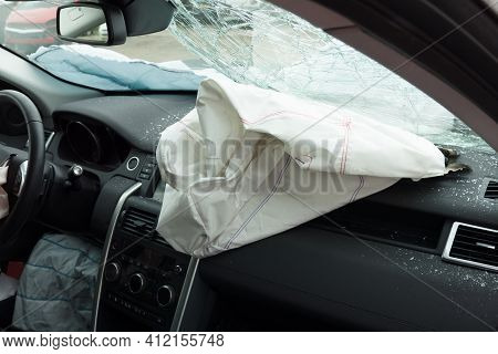 Interior Of A Automobile Or Car Involved In A Vehicle Crash With A Deployed Passenger Side Airbag