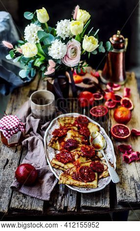 Crepe Suzette With Bloody Oranges.selective Focus. Style Vintage