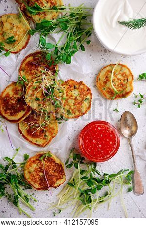 Potato Pancakes With Caviar.top View. Style Rustic. Selective Focus