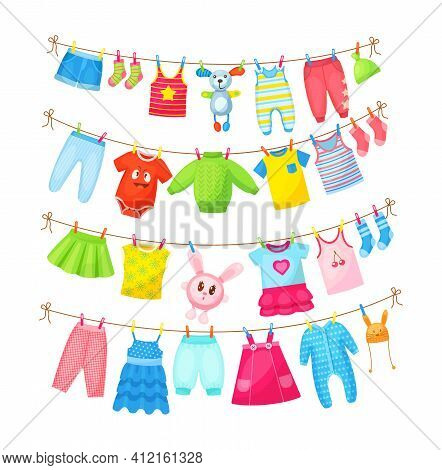 Baby Clothes Hanging On Clothesline. Drying Children's Clothes And Accessories After Washing On Rope