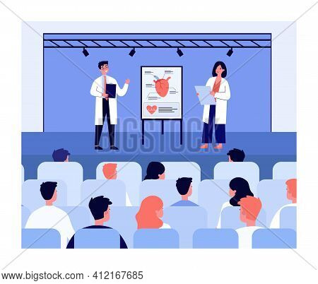Doctors Presenting New Treatment For Heart Disease Before Audience. Flip Chart With Human Heart And